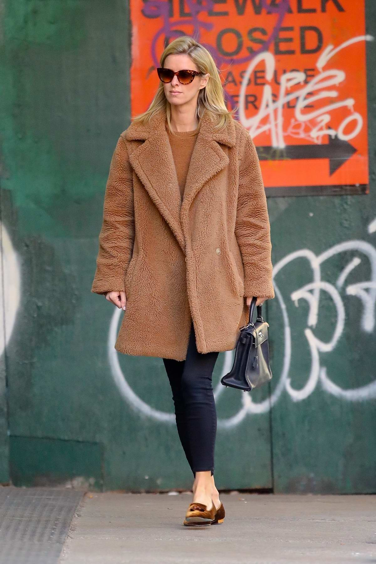 Nicky Hilton wears a brown Max Mara coat while out for stroll in New York City