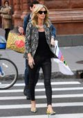 Nicky Hilton wears a snakeskin print blazer and black tights as she makes a stop by AOL building in New York City