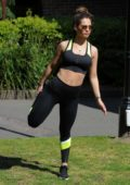 Nicole Bass seen doing some stretches outside her house during the lockdown in Essex, UK