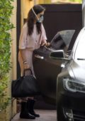 Nina Dobrev seen wearing a surgical mask as she unloads her car after shopping for essentials in Los Angeles