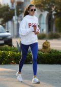 Nina Dobrev wears a Polo hoodie and blue leggings while out for a run in Los Angeles