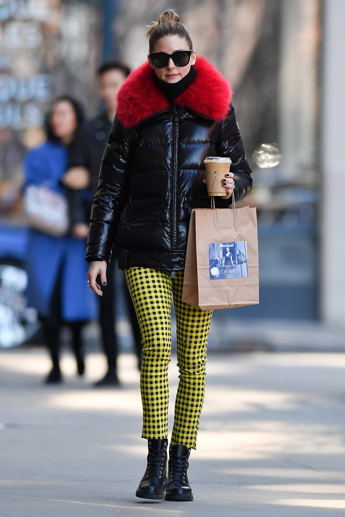 Olivia Palermo seen wearing yellow patterned pants with red fur lined black jacket while out in Brooklyn, New York City