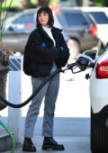 Rebecca Black seen wearing bright blue latex gloves while pumping gas in Los Angeles
