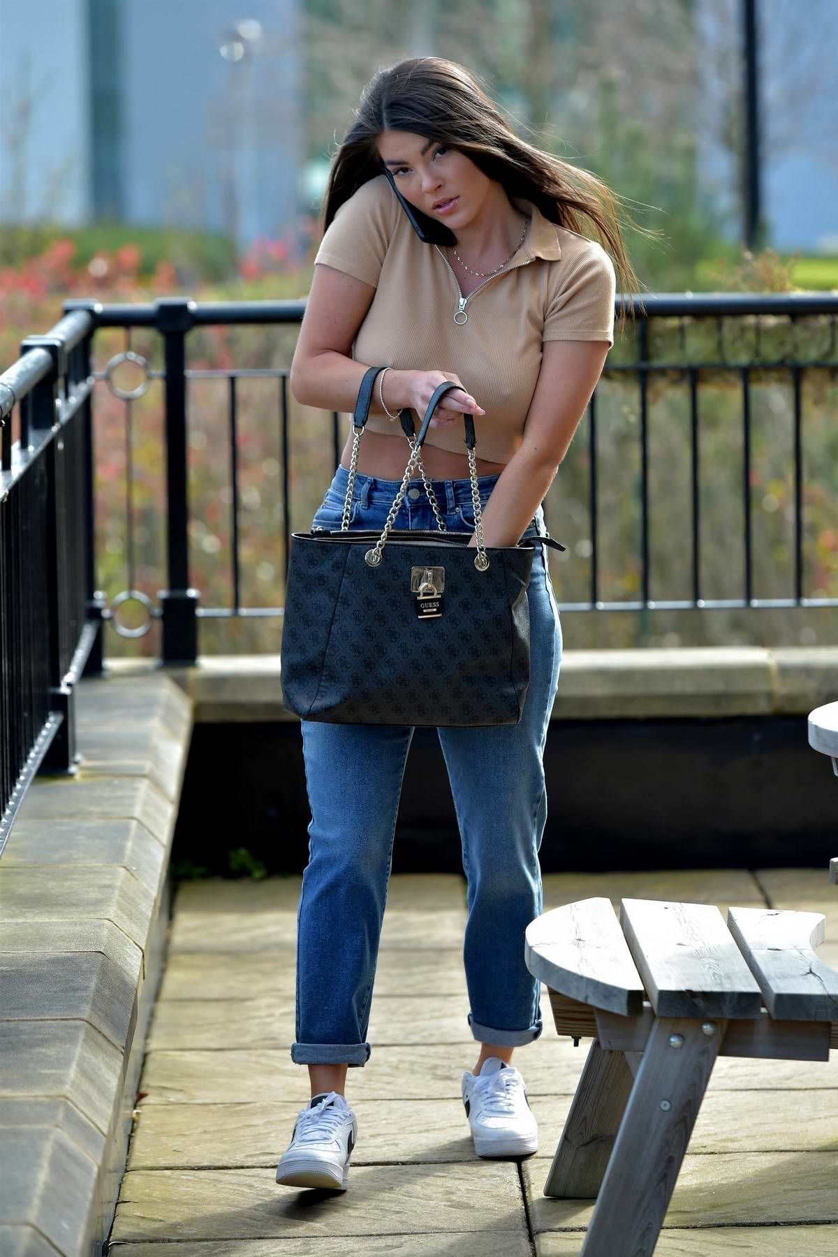Rebecca Gormley wears a beige crop top and jeans as she leaves her home in Newcastle, UK