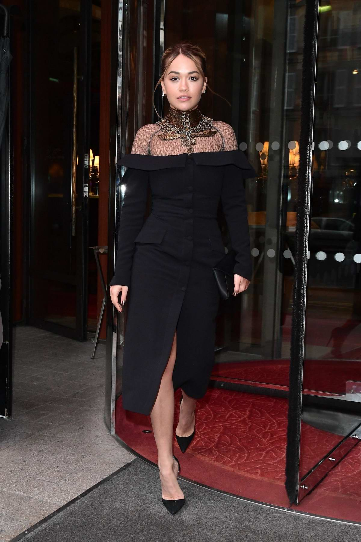 Rita Ora looks great in a black dress as she leaves Le Royal Monceau hotel in Paris, France