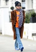 Rita Ora seen wearing a brown coat and checkered scarf as she steps out for some shopping in London, UK