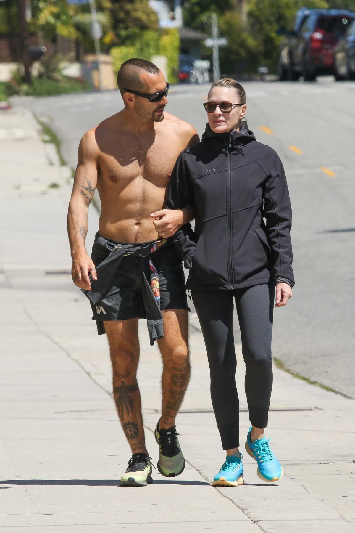 Robin Wright and husband Clement Giraudet keep their fit bodies in shape with a walk in Santa Monica, California