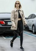 Rosie Huntington-Whiteley flashes her toned abs after a workout session at 'Body By Simone' gym in Beverly Hills, California