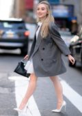 Sabrina Carpenter looks great in a white dress while out in Midtown, New York City