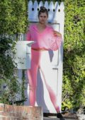 Taylor Hill is pretty in pink as she steps our in her socks to walk her dog with boyfriend Daniel Fryer in Los Angeles