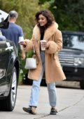 Vanessa Hudgens is all smiles and covered in a faux fur coat as she wraps up a photo shoot in Los Feliz, California