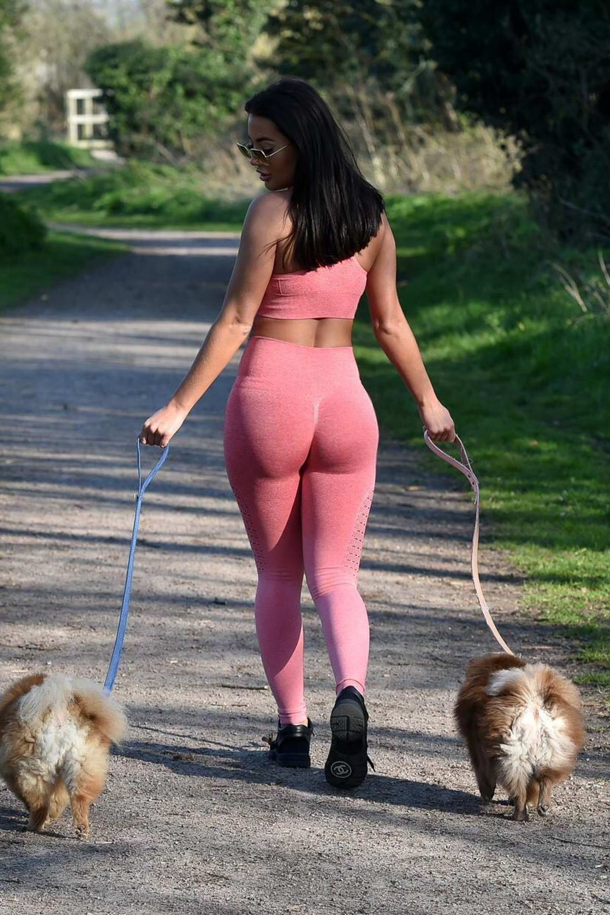 Yazmin Oukhellou flaunts her toned figure in pink workout gear while out to walk her dogs in Harlow, Essex, UK