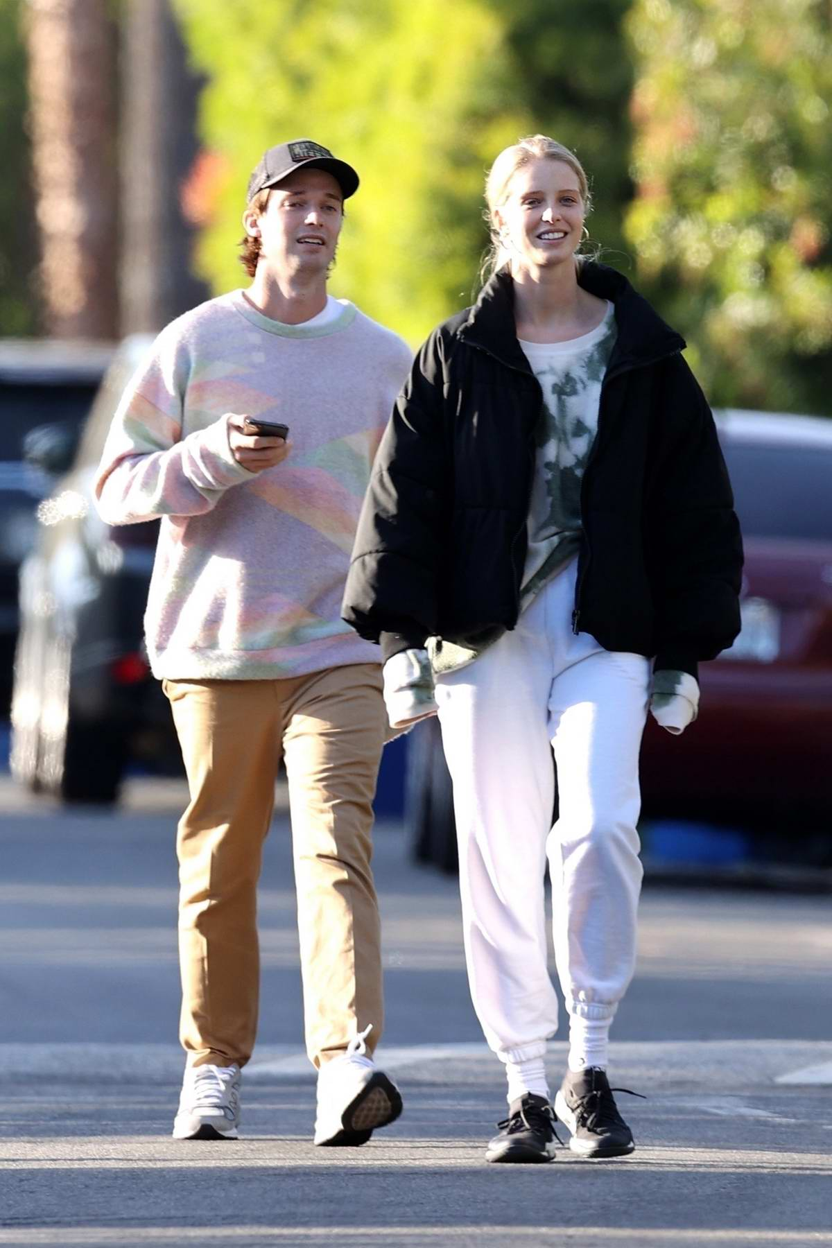 Abby Champion and Patrick Schwarzenegger are all smiles while out for a walk around Brentwood, California