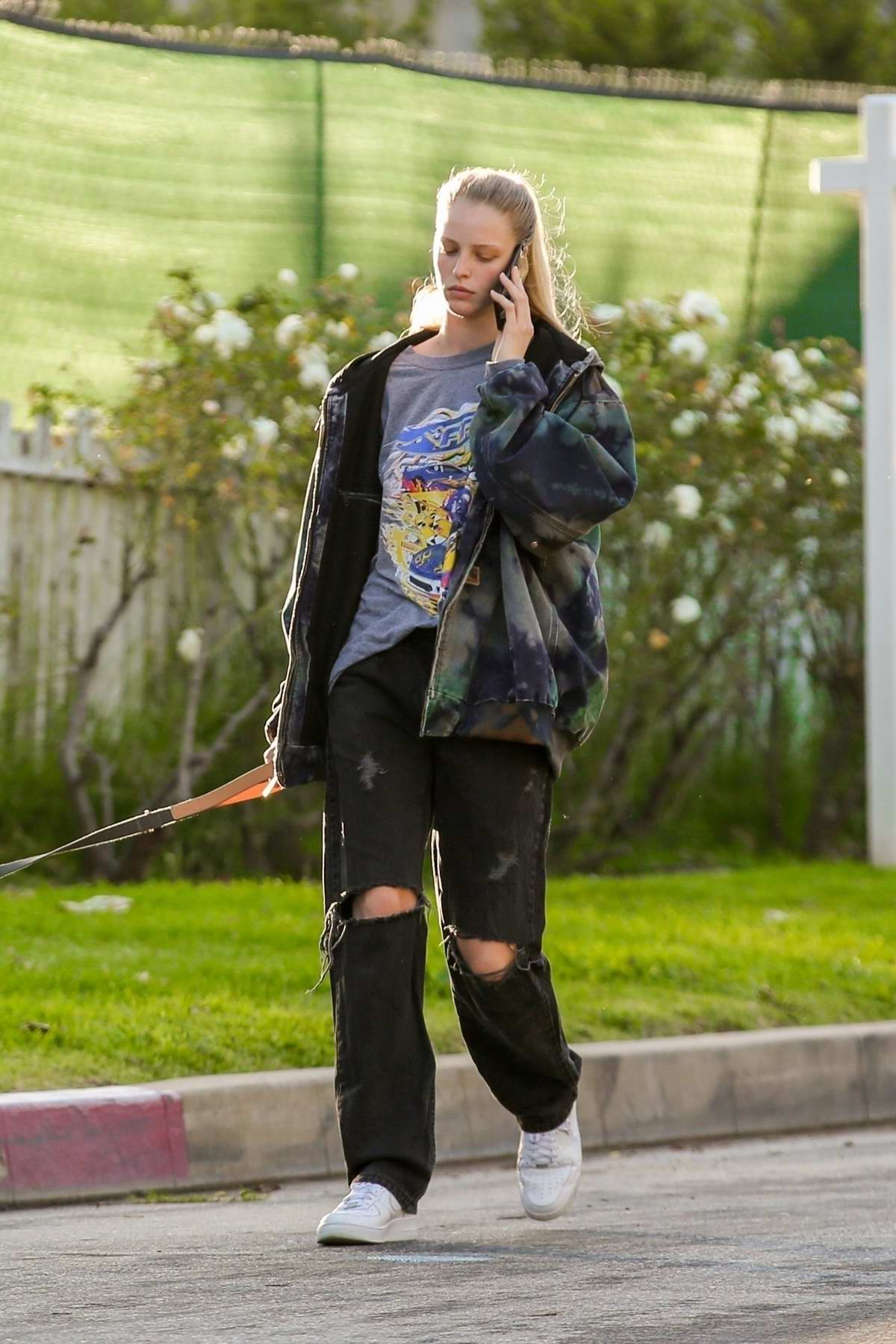 Abby Champion steps out for a walk with Patrick Schwarzenegger in Pacific Palisades, California