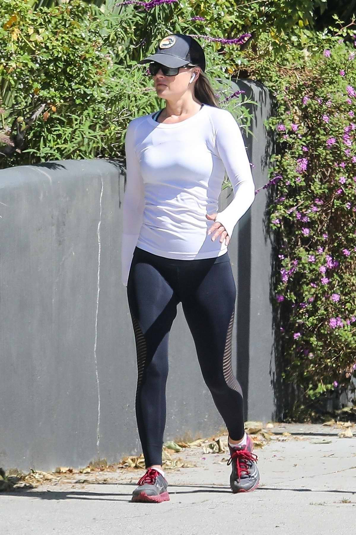 Ali Larter looks fit in a white top and black leggings while out for her daily work in Santa Monica, California