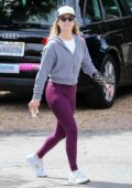 Ali Larter wears a grey jacket and purple leggings with a wrist brace while out for a power walk in Brentwood, California