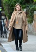 Alice Eve bundles up in a beige turtleneck sweater with matching coat while out during the lockdown in London, UK