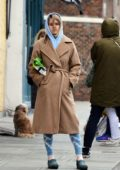 Alice Eve spotted in a brown coat over a blue hoodie while lining up at a butcher shop in West London, UK