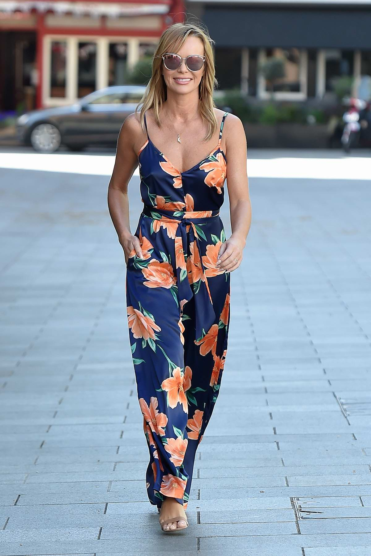 Amanda Holden dons a floral print jumpsuit as she leaves Global Studios in London, UK