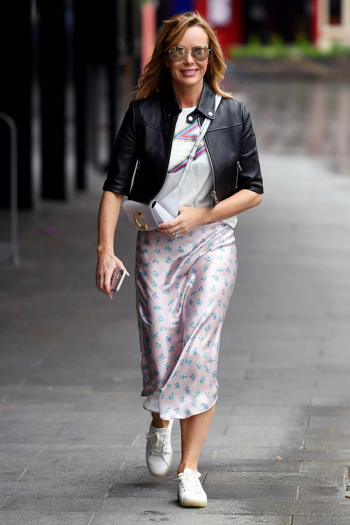 Amanda Holden seen wearing a black leather jacket as she leaves Global Studios in London, UK