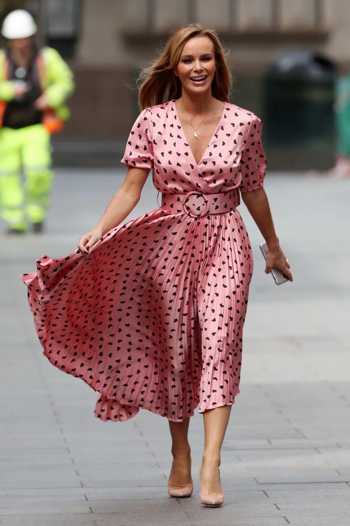 Amanda Holden seen wearing a pink heart print dress as she leaves Global Radio studios in London, UK