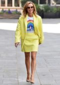 Amanda Holden seen wearing a yellow blazer and skirt with NHS top while leaving Global Studio in London, UK