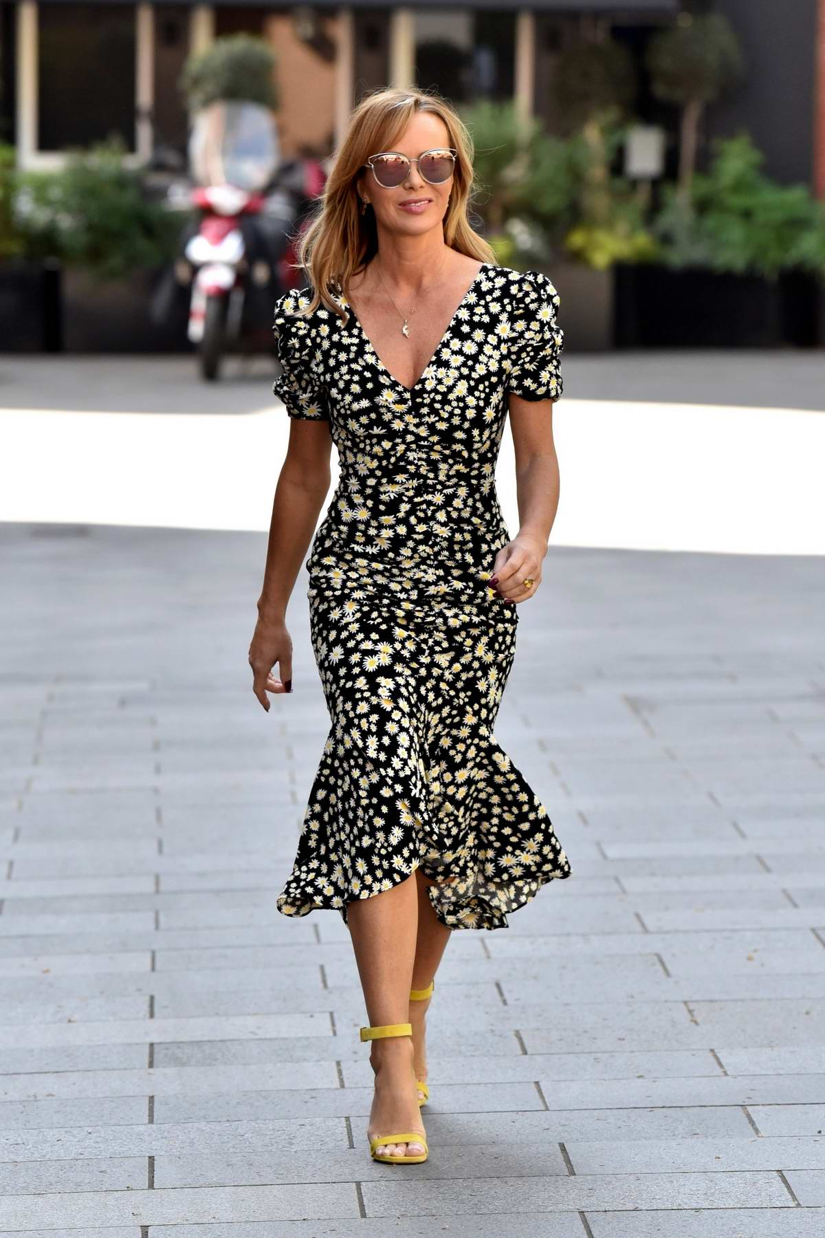 Amanda Holden seen wearing floral print dress as she leaves after Heart Radio Breakfast show in London, UK