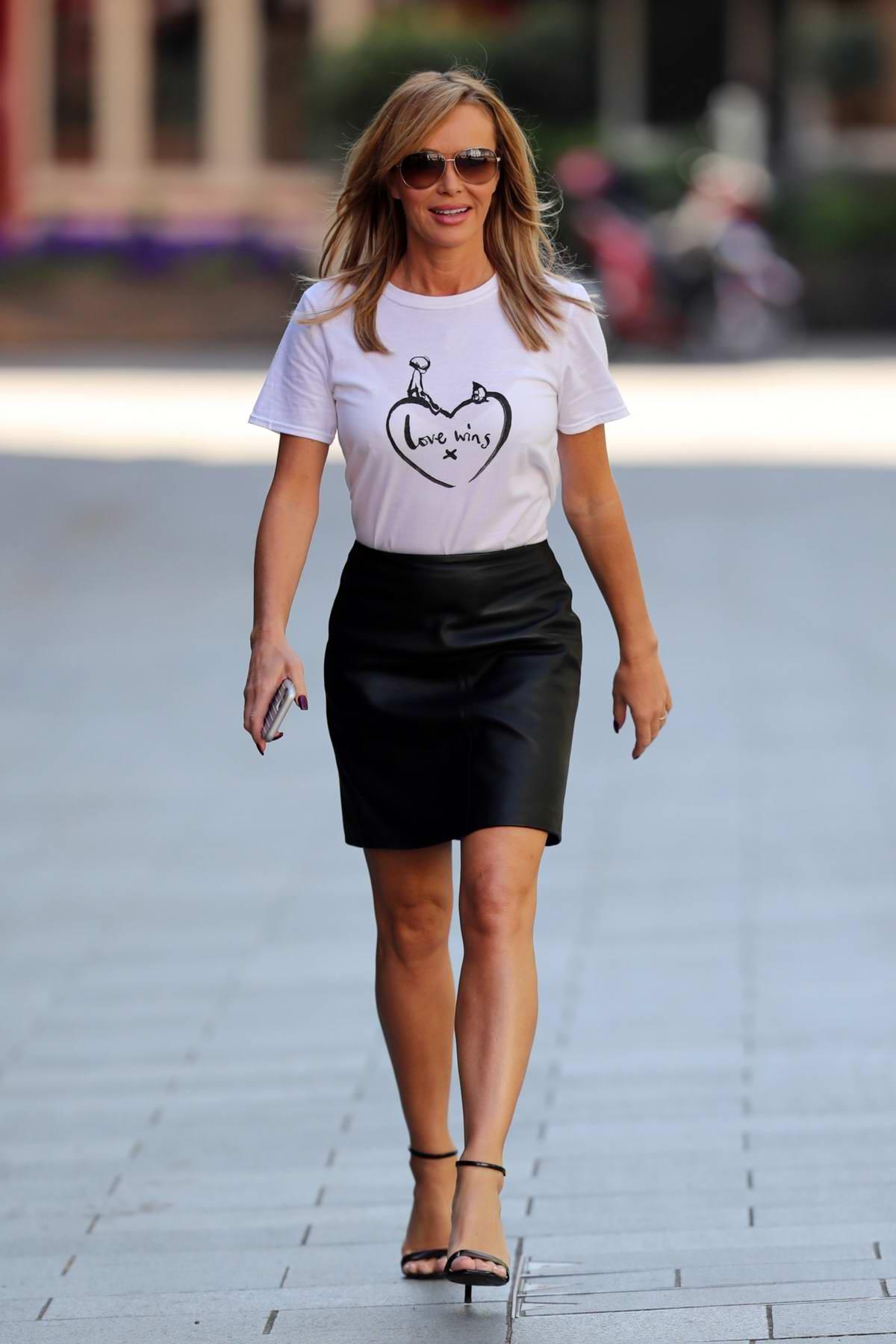 Amanda Holden wears Ted Baker top and black leather mini skirt as she leaves Heart Radio in London, UK