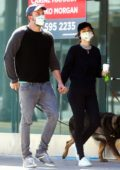 Ana De Armas and Ben Affleck hold hands as they step out for a stroll with their dogs in Los Angeles
