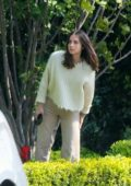Ana de Armas and Ben Affleck look to stay in as they receive a Postmates delivery at home for lunch in Brentwood, California