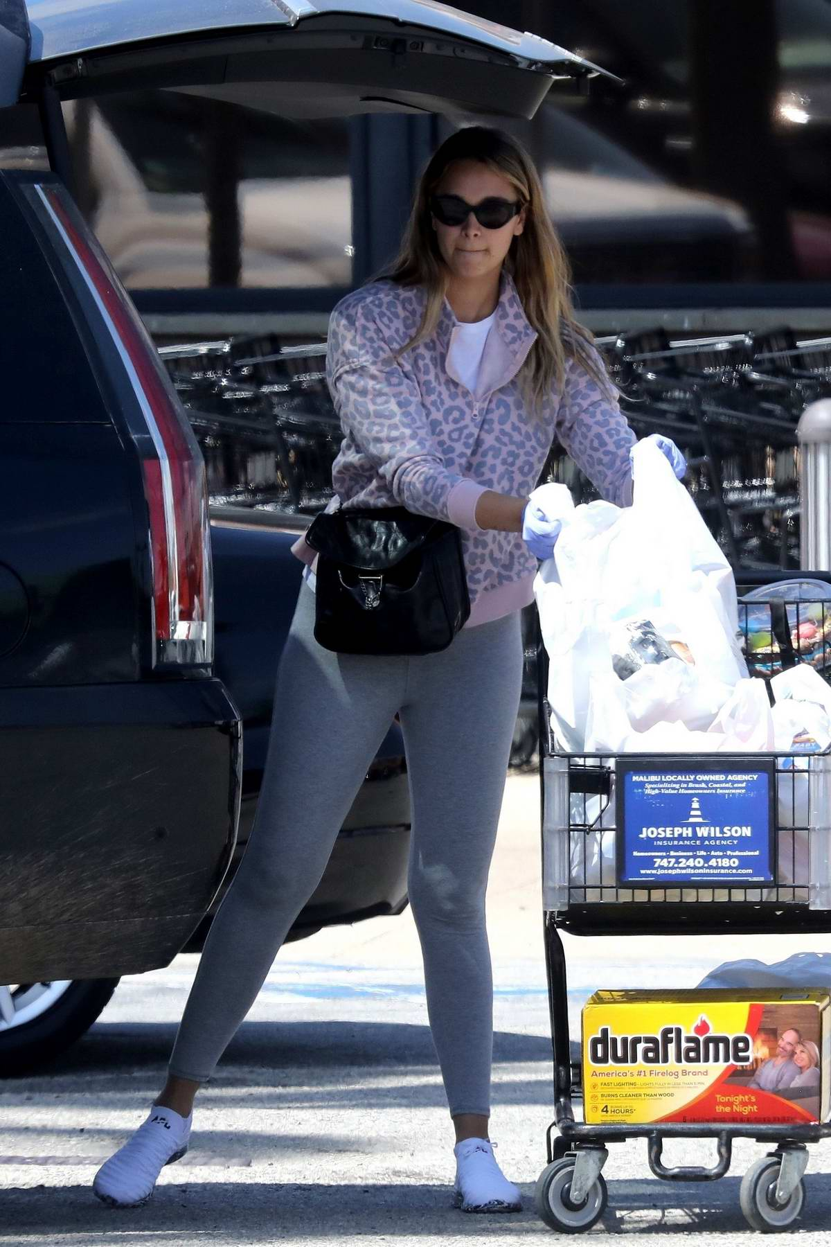 April Love Geary picks up some food supplies and birthday balloons in Malibu, California