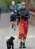 Ashley James looks great in a black leather jacket and burnt orange skirt while out for walk with her dog in London, UK