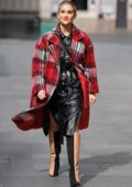 Ashley Roberts looks great in black leather outfit and red plaid coat as she arrives at Global Radio in London, UK