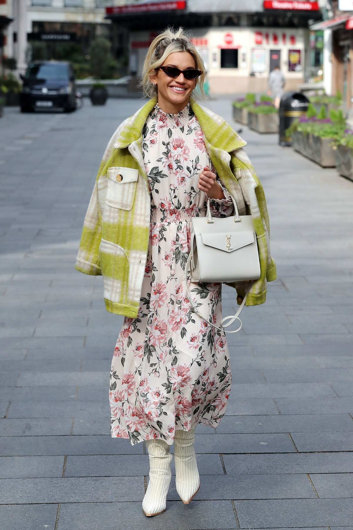 Ashley Roberts looks pretty in a floral print dress as she leaves the Global studios in London, UK