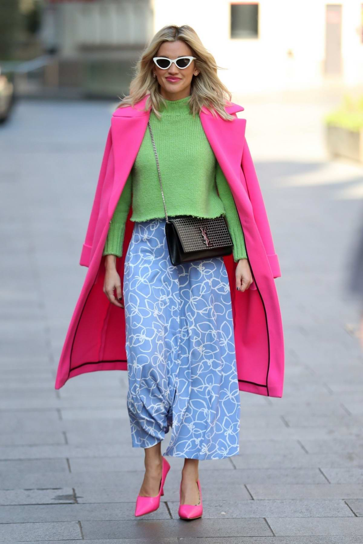 Ashley Roberts puts on a colorful display as she leaves Heart Radio in London, UK