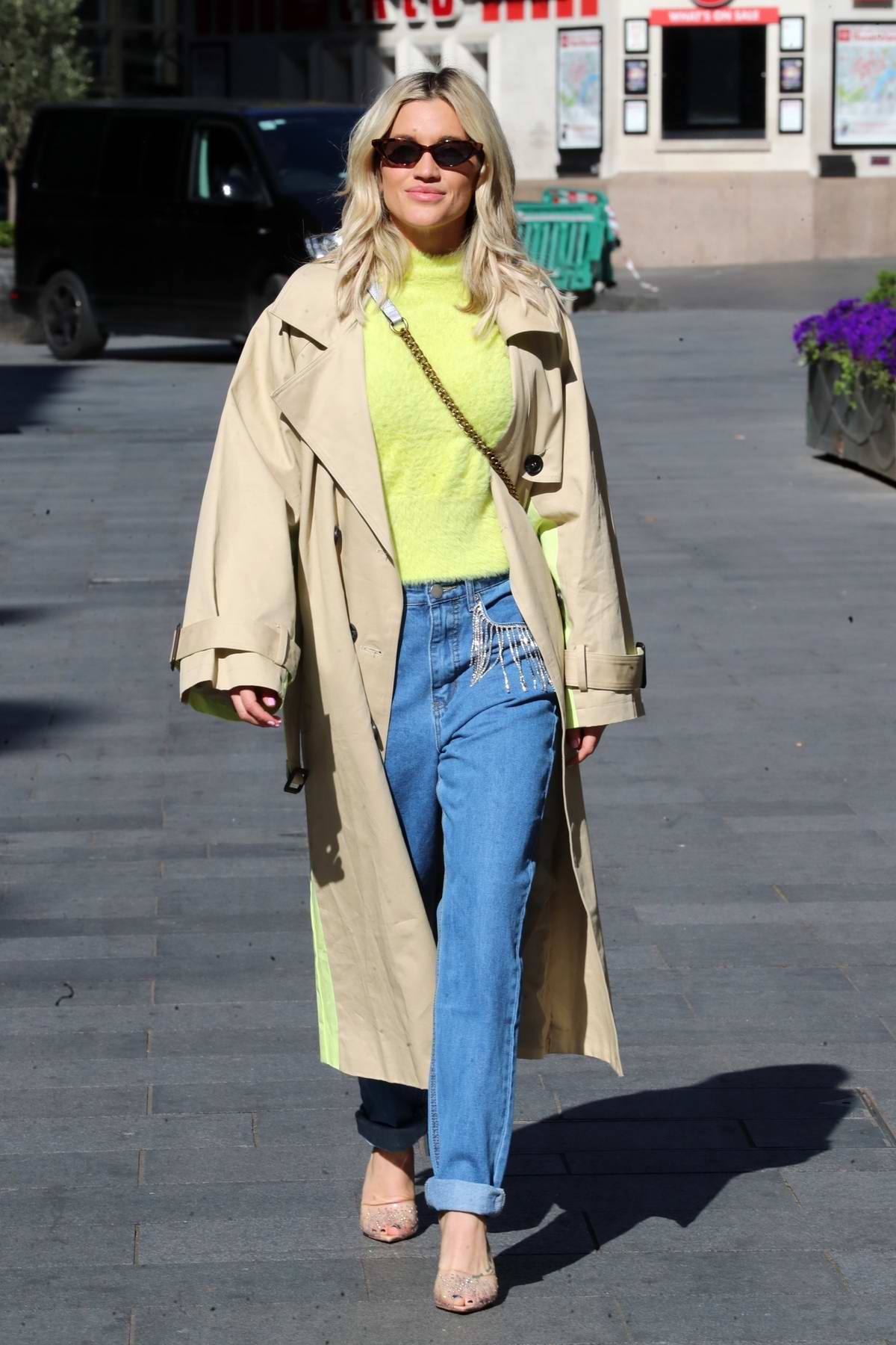 Ashley Roberts seen leaving the Heart Radio Studios in denim trousers and fluffy top in London, UK
