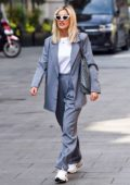 Ashley Roberts spotted in Pinstriped pantsuit as she leaves the Heart Radio Breakfast show in London, UK