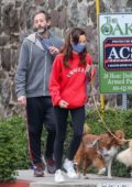 Aubrey Plaza and Jeff Baena wear protective masks while walking their dogs in Los Angeles