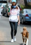Aubrey Plaza enjoys her morning coffee while walking her dogs with a friend in Los Angeles