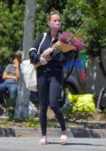 Brie Larson stops by a farmer's market wearing a face mask in Malibu, California