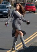 Chloe Goodman wears a form-fitting grey dress as she heads for a Doctor's appointment in London, UK