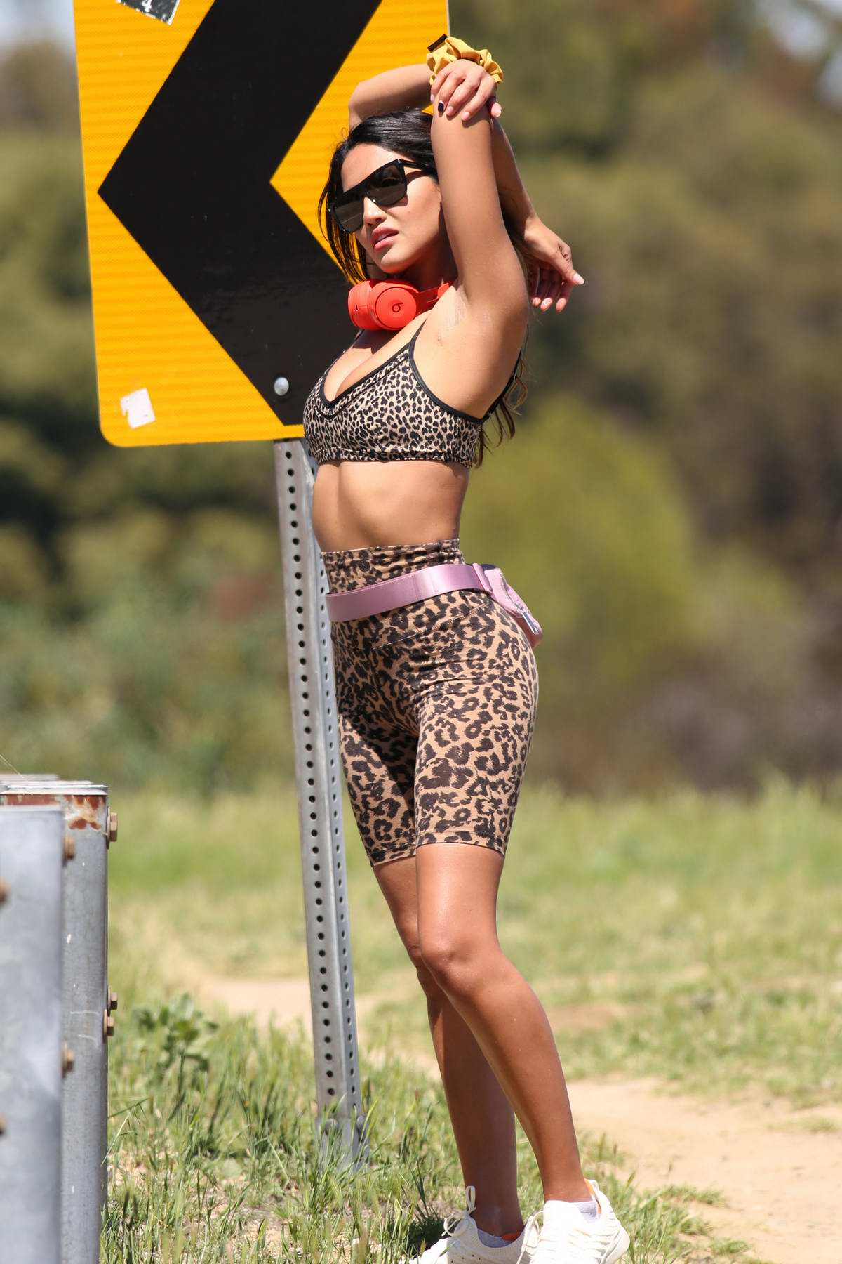 CJ Franco rocks animal print workout top and legging shorts while out for a run in Beverly Hills, California