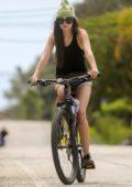 Dakota Jonhson enjoys a bike ride with Chris Martin and his daughter Apple Martin in Malibu, California