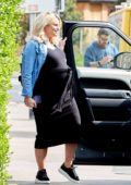 Danielle Armstrong shows off her massive baby bump while out with fiance Tom Edney in Essex, UK
