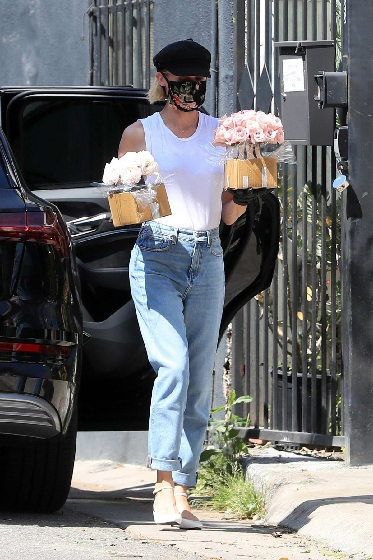 Diane Kruger and Norman Reedus make a trip over to a flower shop to pick out some flowers in West Hollywood, California