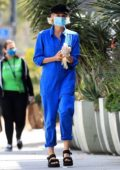 Diane Kruger puts on some latex gloves as she steps out in a blue jumpsuit in West Hollywood, California