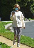 Diane Kruger wears animal print sweatpants as she takes a walk in Los Angeles