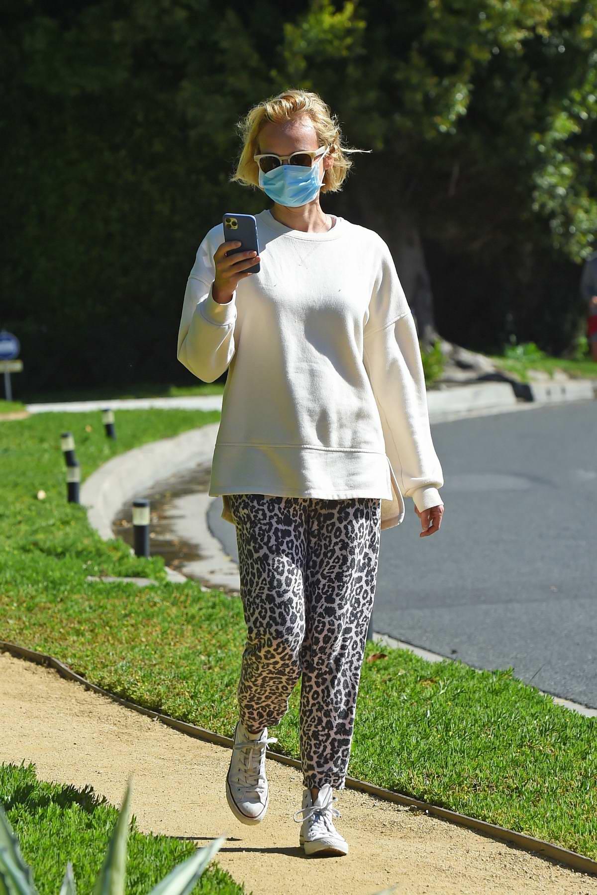 Diane Kruger wears animal print sweatpants as she takes a walk in Los Angeles
