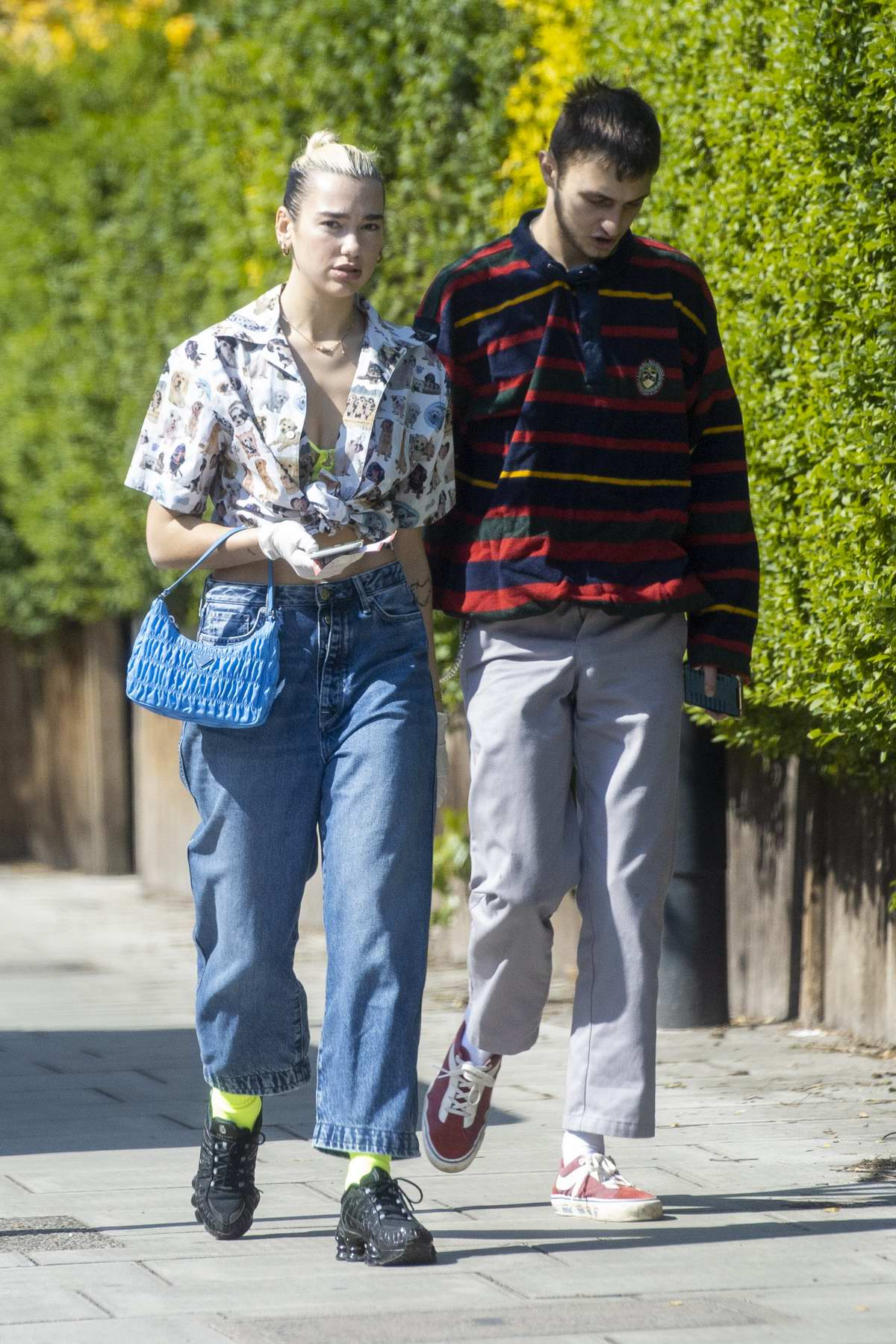 Dua Lipa and Anwar Hadid seen out running errands wearing protective gloves in London, UK