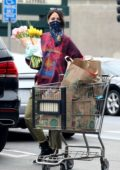 Eiza González wears a bandana mask with gloves while shopping groceries in Los Angeles